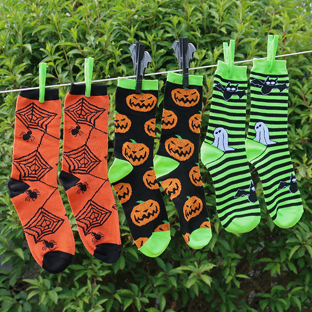 Spooky socks in three designs on a washing line