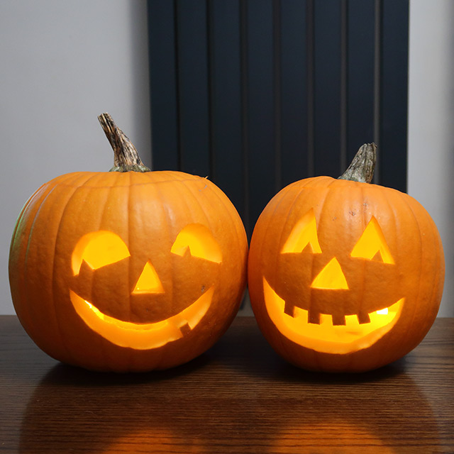 Two fairly large carved pumpkins