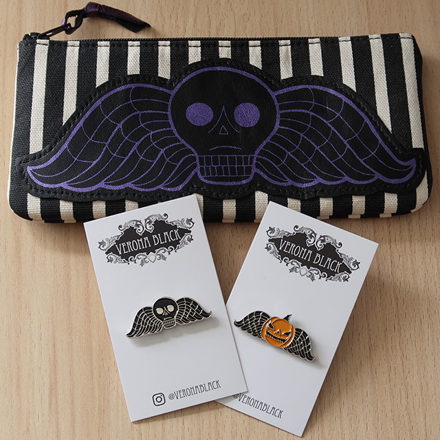 A Deathshead striped pouch and a pair of pins by Verona Black